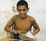Youth at Belén Convent in Havana learns shoe repair.